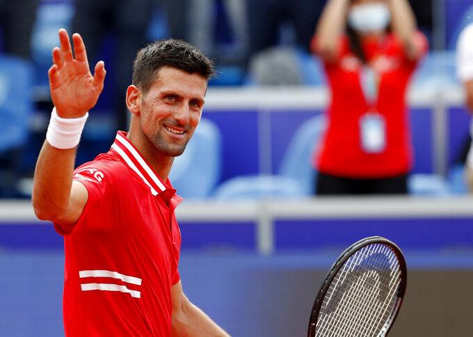 Novak Djokovic of Serbia celebrates after winning against Federico Coria of Argentina in their tennis match, during the Belgrade Open tennis tournament in Belgrade, Serbia, Thursday, May 27, 2021. (AP Photo/Darko Vojinovic)