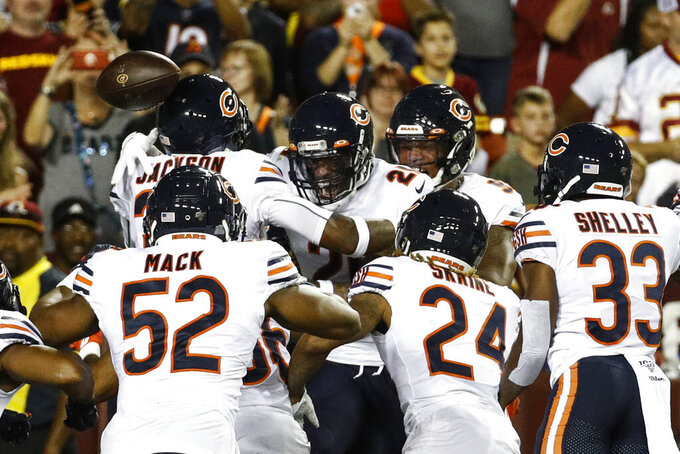 Chicago Bears strong safety Ha Ha Clinton-Dix (21) center, celebrates his interception and touchdown with his teammates during the first half of an NFL football game against the Washington Redskins, Monday, Sept. 23, 2019, in Landover, Md. (AP Photo/Patrick Semansky)