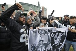 Oakland Raiders fans cheer outside Lambeau Field before an NFL football game against the Green Bay Packers Sunday, Oct. 20, 2019, in Green Bay, Wis. (AP Photo/Mike Roemer)