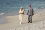 The Prince of Wales and the Duchess of Cornwall walk along Grand Anse beach during a one day visit to the Caribbean island of Grenada on Saturday March 23, 2019. (Jane Barlow/PA via AP)
