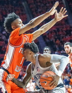 Penn State' guard Jamari Wheeler (5) runs into the defense of Illinois guard Trent Frazier (1) during the second half of an NCAA college basketball game in Champaign, Ill., Saturday, Feb. 23, 2019.(AP Photo/Robin Scholz)