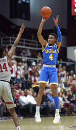 UCLA guard Jaylen Hands (4) takes a 3-point shot over Stanford guard Marcus Sheffield (14) during the first half of an NCAA college basketball game Saturday, Feb. 16, 2019, in Stanford, Calif. (AP Photo/Tony Avelar)