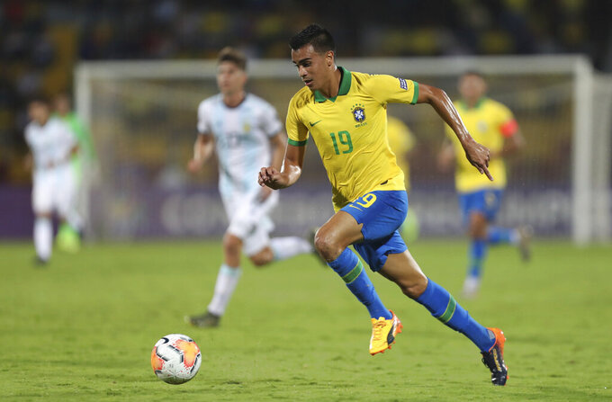 Brazil's Reinier dribbles the ball upfield during a South America Olympic qualifying U23 soccer matchagainst Argentina at the Alfonso Lopez stadium in Bucaramanga, Colombia, Sunday, Feb. 9, 2020. (AP Photo/Fernando Vergara)