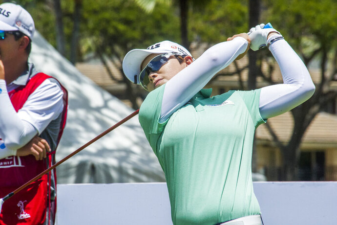 Eun-Hee Ji watches her tee shot on the 10th hole during the second round of the LPGA's Lotte Championship golf tournament Thursday, April 18, 2019, in Kapolei, Hawaii. (Craig T. Kojima/Honolulu Star-Advertiser via AP)