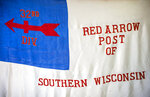 A flag for the 32nd Division Red Arrow Club of Southern Wisconsin, which is disbanding after a 95-year run, is seen here on July 5, 2019, in Janesville, Wis.  (Angela Major/The Janesville Gazette via AP)