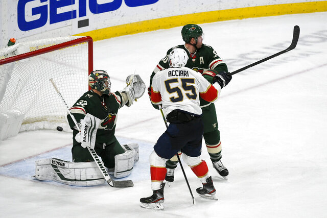 Florida Panthers right wing Noel Acciari, right, tips the puck past Minnesota Wild defenseman Ryan Suter (20) and goalie Alex Stalock to score the game winning goal with six seconds left in the third period of an NHL hockey game Monday, Jan. 20, 2020, in St. Paul, Minn. The Panthers won 5-4. (AP Photo/Craig Lassig)