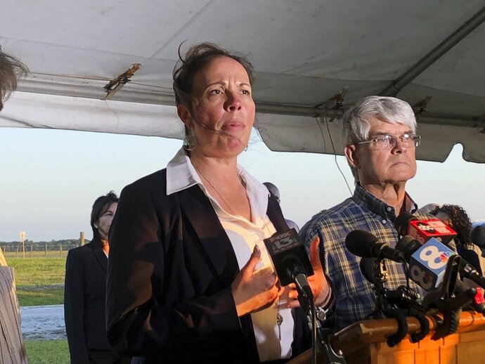 Lisa Noland, who survived an attack at the hands of serial killer Bobby Joe Long, speaks to reporters after his execution May 23, 2019, in Starke, Fla. Bobby Joe Long, a serial killer who terrorized Florida with a 1984 spree that claimed the lives of 10 women was put to death Thursday, his execution witnessed by the woman who survived one of his attacks and aided in his capture.(AP Photo/Brendan Farrington)