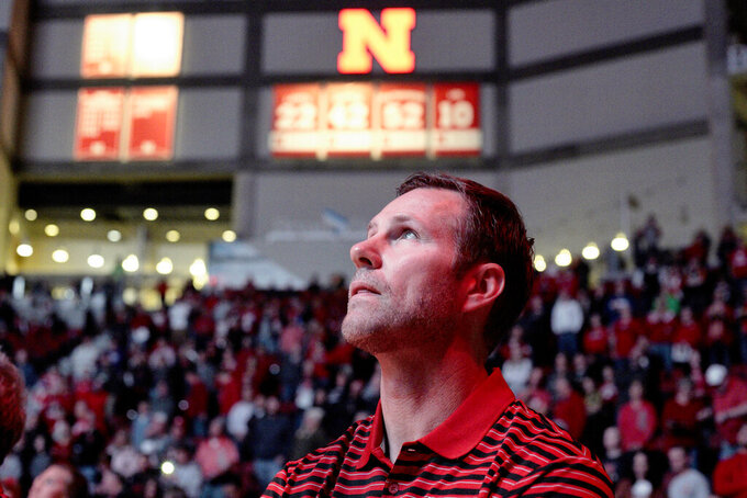 In this Oct. 30, 2019 photo, In this Wednesday, Oct. 30, 2019 photo, Nebraska coach Fred Hoiberg looks at the overhead screen during player introductions before an NCAA college basketball exhibition game against Doane University in Lincoln, Neb. Hoiberg knows the track record of Nebraska basketball coaches is not good. He wanted the job anyway. He takes over a program that has not won a conference championship in 70 years or ever won a game in the NCAA Tournament. He says a sold-out arena and top-notch facilities can trump the program's lack of tradition. (AP Photo/Nati Harnik)