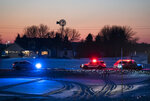 Police block off a road leading to the scene of a Blackhawk helicopter that crashed in the woods neat Marty, Minn., Thursday, Dec. 5, 2019. A Black Hawk helicopter with three crew members aboard crashed Thursday in central Minnesota, the Minnesota National Guard said, though officials did not offer any immediate information about the conditions of crew members. (Renee Jones Schneider/Star Tribune via AP)