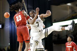 Vanderbilt guard Maxwell Evans (3) and Alabama guard John Petty Jr. (23) fight for a rebound in the second half of an NCAA college basketball game Wednesday, Jan. 22, 2020, in Nashville, Tenn. (AP Photo/Mark Humphrey)