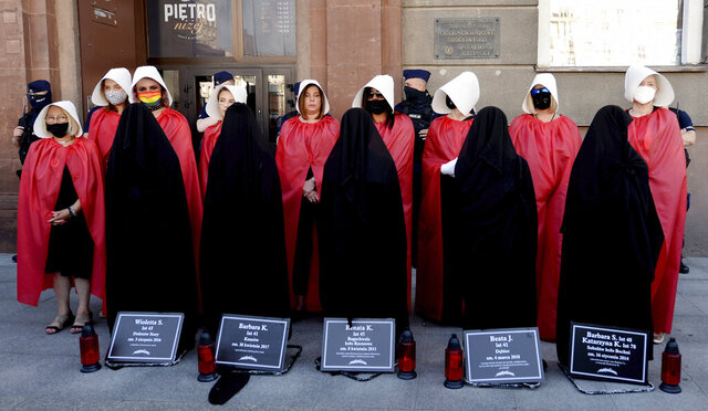File-In this file photo from July 24, 2020, women dressed to evoke the feminist dystopian story