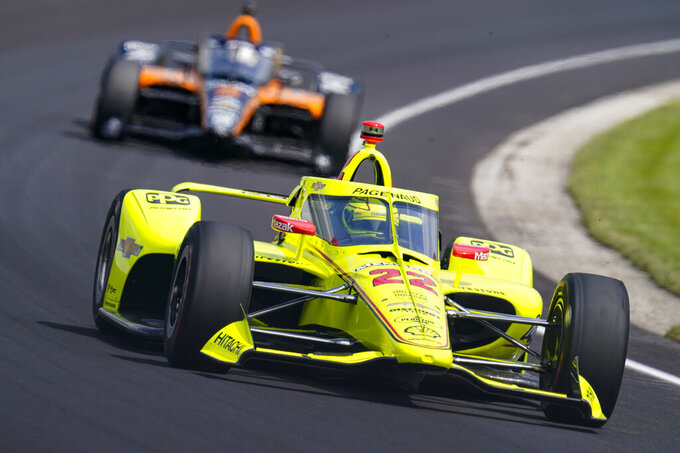 Simon Pagenaud, of France, drives through the third turn during practice for the Indianapolis 500 auto race at Indianapolis Motor Speedway in Indianapolis, Thursday, Aug. 13, 2020. (AP Photo/Michael Conroy)
