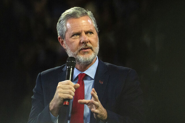 FILE - In this, Nov. 13 2019, file photo, Liberty University President Jerry Falwell Jr. talks to Donald Trump Jr. about his new book