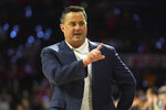 FILE - In this March 5, 2020, file photo, Arizona head coach Sean Miller gestures during the first half of an NCAA college basketball game against Washington State in Tucson, Ariz. Arizona lost three star freshmen who turned pro and its top six scorers from last season. Nico Mannion, Josh Green and Zeke Nnaji may be gone, but Miller has restocked the roster with talented players, six from outside the United States. (AP Photo/Rick Scuteri, File)