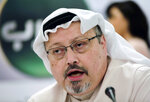 FILE - In this Dec. 15, 2014, file photo, Saudi journalist Jamal Khashoggi speaks during a news conference in Manama, Bahrain. A Saudi dissident has accused NSO Group in a lawsuit of helping his country take over his smartphone and spy on his communications with Saudi journalist Jamal Khashoggi, who was killed by a hit squad and dismembered in the Saudi consulate in Istanbul in 2018. (AP Photo/Hasan Jamali, File)