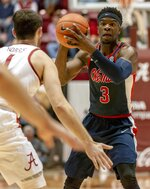 Mississippi guard Terence Davis (3) looks for a passing lane as he is defended by Alabama's Riley Norris (1) during the first half of an NCAA college basketball game, Tuesday, Jan. 22, 2019, in Tuscaloosa, Ala. (AP Photo/Vasha Hunt)