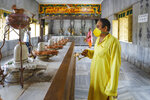 An Indian priest wearing a mask as a precaution against the coronavirus offers prayers to a row of Shivlings, idols symbolic of Hindu god Shiva, at a temple in Prayagraj, India, Monday, July 6, 2020. India has overtaken Russia to become the third worst-affected nation by the coronavirus pandemic. (AP Photo/Rajesh Kumar Singh)