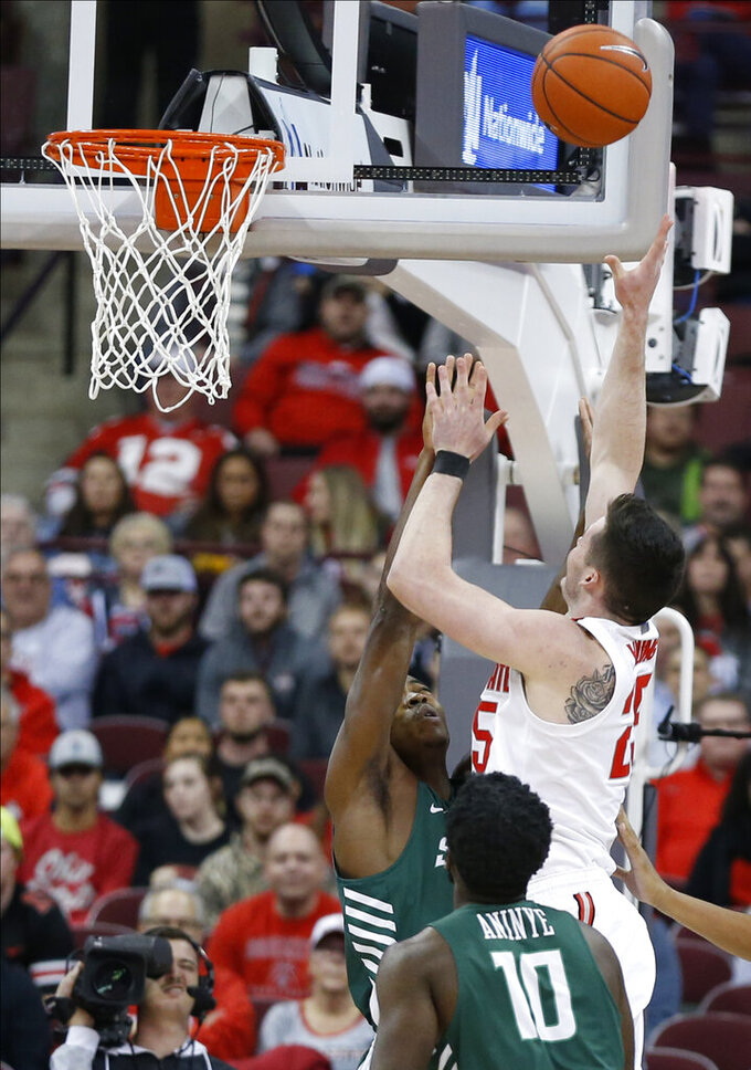 Ohio State's Kyle Young, right, shoots over Stetson's Rob Perry during the first half of an NCAA college basketball game Monday, Nov. 18, 2019, in Columbus, Ohio. (AP Photo/Jay LaPrete)