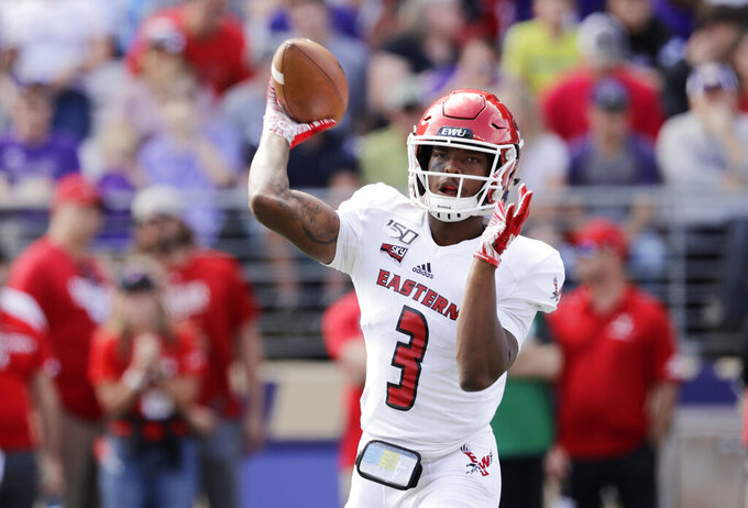 FILE - Eastern Washington quarterback Eric Barriere passes against Washington in the first half of an NCAA college football game in Seattle, in this Saturday, Aug. 31, 2019, file photo. Barriere is a member of The Associated Press FCS All-America team, announced Wednesday, May 12, 2021. (AP Photo/Elaine Thompson, File)