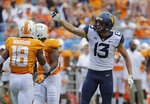 West Virginia's David Sills (13) celebrates making a first down against Tennessee in the first half of an NCAA college football game in Charlotte, N.C., Saturday, Sept. 1, 2018. (AP Photo/Chuck Burton)