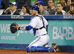 Toronto Blue Jays catcher Danny Jansen (9) finds the ball after a wild pitch by starting pitcher Sean Reid-Foley against the Baltimore Orioles during first-inning baseball game action in Toronto, Monday, April 1, 2019. (Nathan Denette/The Canadian Press via AP)