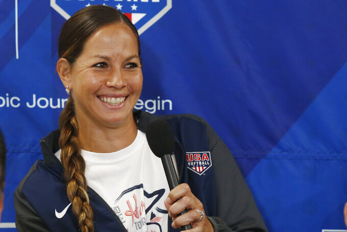 FILE - Pitcher Cat Osterman smiles as she answers a question during a news conference to announce the USA Softball 2020 Women's Olympic Team in Oklahoma City, in this Tuesday, Oct. 8, 2019, file photo. Osterman says she will retire from the sport this year. The left-handed pitcher will represent Team USA at the Olympics before defending the Athletes Unlimited title she won last season at age 37. She surprised herself by claiming the Athletes Unlimited title and takes added confidence into her run at a second Olympic gold medal. (AP Photo/Sue Ogrocki, File)