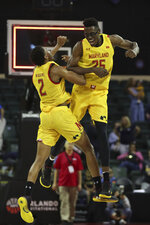 Maryland forwards Jalen Smith (25) and Makhel Mitchell (22) celebrate after defeating Marquette in an NCAA college basketball game Sunday, Dec. 1, 2019, in Lake Buena Vista, Fla. (AP Photo/Scott Audette)