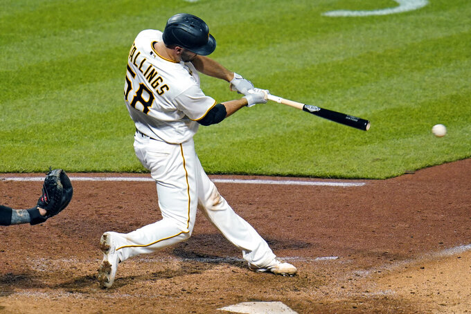 Pittsburgh Pirates' Jacob Stallings singles off Miami Marlins relief pitcher Zach Pop, driving in two runs, during the sixth inning of a baseball game in Pittsburgh, Friday, June 4, 2021. (AP Photo/Gene J. Puskar)
