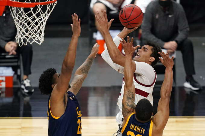 Stanford's Oscar da Silva (13) shoots over California's Andre Kelly, left, and Matt Bradley during the second half of an NCAA college basketball game in the first round of the Pac-12 men's tournament Wednesday, March 10, 2021, in Las Vegas. (AP Photo/John Locher)
