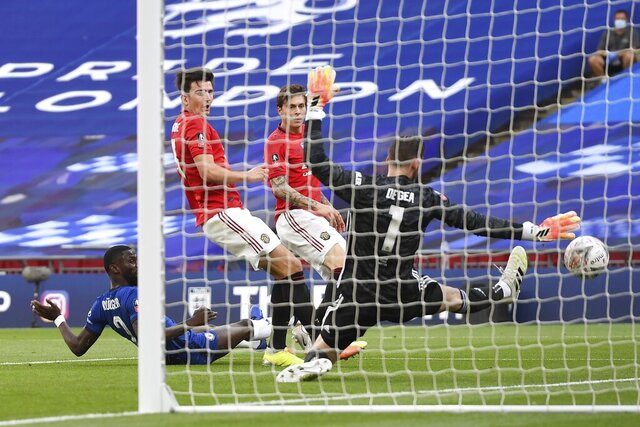 Manchester United's goalkeeper David de Gea fails to stop the third goal during the English FA Cup semifinal soccer match between Chelsea and Manchester United at Wembley Stadium in London, England, Sunday, July 19, 2020. (Andy Rain, Pool via AP)