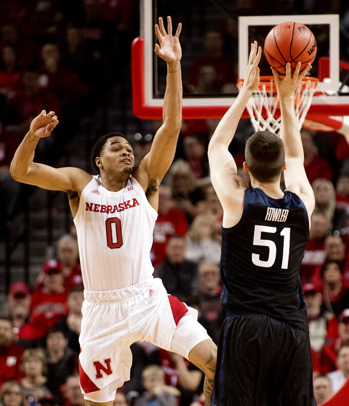 Butler's Nate Fowler (51) shoots a 3-pointer as Nebraska guard James Palmer Jr. (0) defends during the first half of an NCAA college basketball game in the NIT on Wednesday, March 20, 2019, in Lincoln, Neb. (Francis Gardler/Lincoln Journal Star via AP)