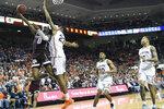 Texas A&M guard Jay Jay Chandler (0) shoots over Auburn forward Isaac Okoro (23) during the first half of an NCAA college basketball game Wednesday, March 4, 2020, in Auburn, Ala. (AP Photo/Julie Bennett)