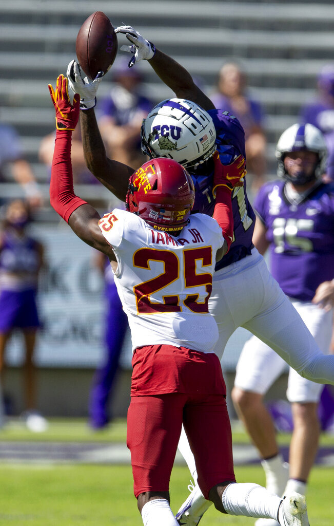 TCU wide receiver Dylan Thomas (11) catches a pass as Iowa State defensive back T.J. Tampa (25) defends during an NCAA college football game on Saturday, Sept. 26, 2020 in Fort Worth, Texas. Iowa won 37-34. (AP Photo/Brandon Wade)