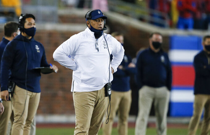 Navy coach Ken Niumatalolo watches from the sideline during the first half of the team's NCAA college football game against SMU, Saturday, Oct. 31, 2020, in Dallas. (AP Photo/Brandon Wade)