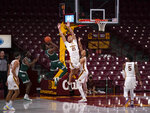 Minnesota's Jarvis Omersa (21) and Brandon Johnson defend against Green Bay's P.J. Pipes during an NCAA college basketball game Wednesday, Nov. 25, 2020, in Minneapolis. (Jeff Wheeler/Star Tribune via AP)