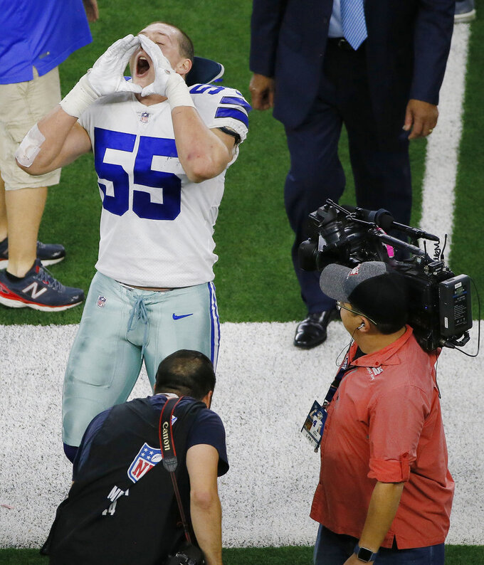 Dallas Cowboys linebacker Leighton Vander Esch (55) does his signature howl at fans as he walks off the field after a NFC wild-card NFL football game against the Seattle Seahawks, in Arlington, Texas, Saturday, Jan. 5, 2019. The Cowboys won 24-22. (AP Photo/Roger Steinman)