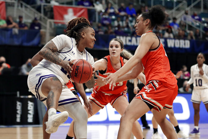 Stephen F. Austin guard Zya Nugent, left, looks for a way around Sam Houston State forward Kaylee Jefferson (13) and forward Madelyn Batista, right, during the first half of an NCAA college basketball game for the Southland Conference women's tournament championship Sunday, March 14, 2021, in Katy, Texas. (AP Photo/Michael Wyke)