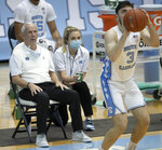 North Carolina coach Roy Williams watches Andrew Platek (3) launch a 3-point shot during the second half of an NCAA college basketball game against North Carolina Central, Saturday, Dec. 12, 2020, at the Smith Center in Chapel Hill, N.C. (Robert Willett/The News & Observer via AP)