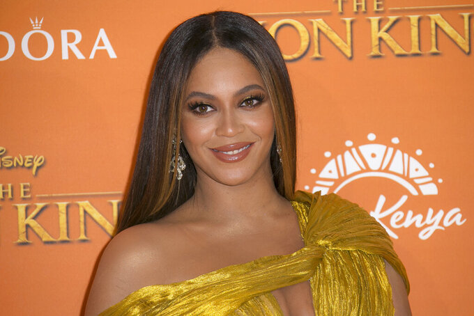 """FILE - This July 14, 2019 file photo shows Beyonce at the """"Lion King"""" premiere in London. Beyonce, along with Timothy McKenzie and Ilya Salmanzadeh, failed to get an Oscar nomination for best original song for """"Spirit,"""" from the film """"The Lion King."""" (Photo by Joel C Ryan/Invision/AP, File)"""