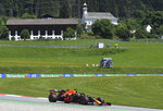 Red Bull driver Max Verstappen of the Netherlands steers his car during the first practice session for the Styrian Formula One Grand Prix at the Red Bull Ring racetrack in Spielberg, Austria, Friday, July 10, 2020. The Styrian F1 Grand Prix will be held on Sunday. (Joe Klamar/Pool via AP)
