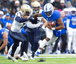 Air Force quarterback Isaiah Sanders (4) stiff-arms Navy cornerback Khaylan Williams (7)  during an NCAA college football game at Falcon Stadium at the U.S. Air Force Academy, Saturday Oct. 6, 2018, in Colorado Springs, Colo.  (Dougal Brownlie,/The Gazette via AP)