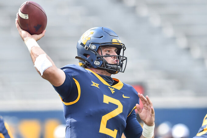 FILE - West Virginia quarterback Jarret Doege (2) makes a pass against Baylor during an NCAA college football game in Morgantown, W.Va., in this Saturday, Oct. 3, 2020, file photo. Doege enters his second full season as the starter as West Virginia opens the season Saturday, Sept. 4, 2021, at Maryland. (William Wotring/The Dominion-Post via AP, File)
