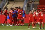 Canada's Cyle Larin (17) celebrates with teammates after scoring against Haiti during the second half of a World Cup qualifying soccer match Tuesday, June 15, 2021, in Bridgeview, Ill. (AP Photo/Kamil Krzaczynski)