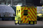 Ambulances and camp tents are seen outside the Excel in London, Saturday, March 28, 2020.The British Government announced Tuesday, that the ExCel Center in east London will become a 4,000 bed temporary hospital to deal with future coronavirus patients, to be called NHS Nightingale. The new coronavirus causes mild or moderate symptoms for most people, but for some, especially older adults and people with existing health problems, it can cause more severe illness or death.(AP Photo/Alberto Pezzali)