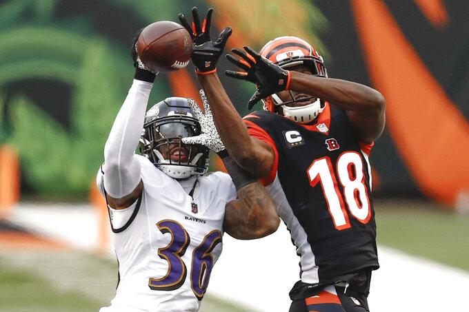 Baltimore Ravens strong safety Chuck Clark (36) breaks up a pass intended for Cincinnati Bengals wide receiver A.J. Green (18) during the second half of an NFL football game, Sunday, Jan. 3, 2021, in Cincinnati. (AP Photo/Aaron Doster)