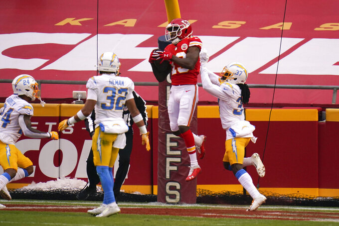 Kansas City Chiefs wide receiver Byron Pringle (13) catches a 3-yard touchdown pass ahead of Los Angeles Chargers cornerback Tevaughn Campbell, right, during the first half of an NFL football game, Sunday, Jan. 3, 2021, in Kansas City. (AP Photo/Jeff Roberson)