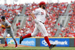 Cincinnati Reds' Tanner Roark runs home to score on a single by Joey Votto off St. Louis Cardinals starting pitcher Dakota Hudson during the third inning of a baseball game Thursday, July 18, 2019, in Cincinnati. (AP Photo/John Minchillo)