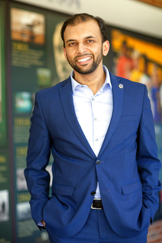 In this March 23, 2019 image provided by the campaign of Qasim Rashid, state Senate candidate Qasim Rashid poses at the Stafford County Courthouse in Stafford, Va.  Joseph Cecil Vandevere, is charged with interstate communication of a threat to injure a person in connection with a tweet directed at Virginia state Senate candidate Qasim Rashid. The tweet included a picture of a lynching and read,