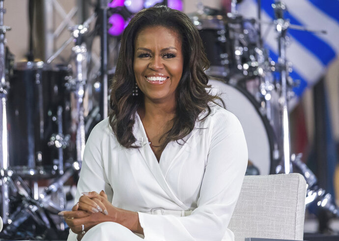 FILE - In this Oct. 11, 2018, file photo, Michelle Obama participates in the International Day of the Girl on NBC's