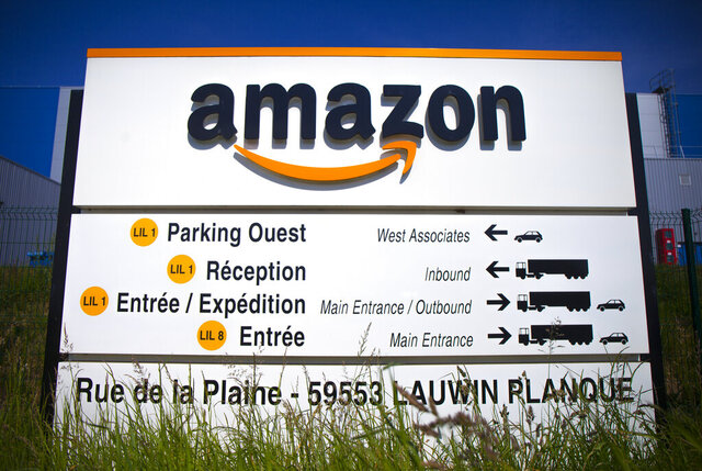 FILE - In this April 16, 2020 file photo, the Amazon logo is seen in Amazon, in Lauwin Planque, northern France. Amazon is gradually reopening its warehouses in France this week after consulting with unions on virus safety measures in an effort to end weeks of legal troubles that had sharply curtailed the company's business. Amazon shut the warehouses last month after French courts ruled that it hadn't done enough to protect workers from the coronavirus. (AP Photo/Michel Spingler)